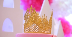 Delicious tiered pink wedding cake decorated with crowns Stock Footage