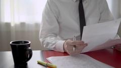 Man looking at paperwork Stock Footage