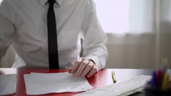Man reviewing paperwork at his desk Stock Footage