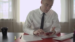 Man uses phone at work Stock Footage