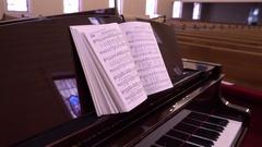 Hymn Book On Piano In Church Stock Footage