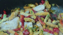 Chakhokhbili with beans frozen ready product cooking in a pan closeup Stock Footage