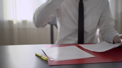 Man drinks coffee while doing paperwork Stock Footage