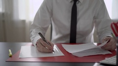 Man makes a to do list at work Stock Footage