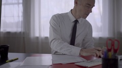 Man going over a proposal at work Stock Footage
