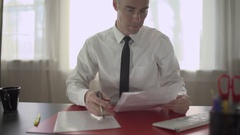 Successful man doing paperwork at his desk Stock Footage