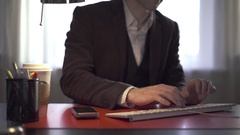 Man typing at his desk Stock Footage