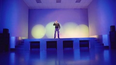 Actor invites someone on stage, then jumping off the stage in the dance floor Stock Footage