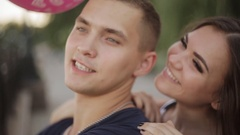A young couple admiring the beauty of the city and stroll along the promenade Stock Footage