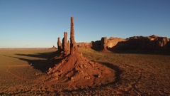 Monument Valley Aerial Shot of Totem Pole at Sunset - Fly Forward Tilt Up Stock Footage