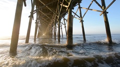 Waves under the pier in the Atlantic Ocean, at Folly Beach, near Charleston, Sou Stock Footage