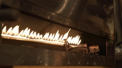 Coffee beans in roaster on burning fire, close-up Stock Footage