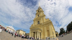 The queue at the Orthodox church, clouds ove the spire of St. Peter and Paul Stock Footage