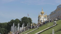 Golden domes of the Church. Russian flag waving in the wind, Russia, Peterhof Stock Footage