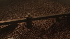 Fresh coffee beens mix in modern roaster Stock Footage