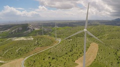 Huge blades rotating in wind for alternative power generation, renewable energy Stock Footage