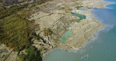 Dead Sea coast line with sinkhole   Aerial Shot Stock Footage