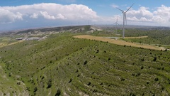 Ecology minded industrial area with plant and wind farm, renewable energy source Stock Footage