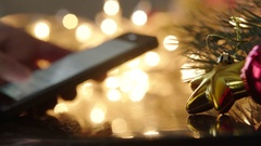 Texting a message on phone on Christmas night, New Year night Stock Footage