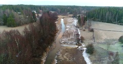 Cinema 4k aerial view of a winter river , at a almost snowless, cloudy dece.. Stock Footage