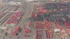 AERIAL: Cargo container transshipment work in progress on maritime port terminal Stock Footage