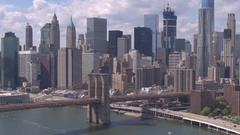 AERIAL: Famous Brooklyn Bridge against Lower Manhattan downtown cityscape Stock Footage