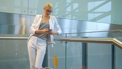 Slow shooting of woman chatting on phone in departure hall Stock Footage