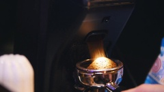 Black coffee pours in a container of coffee machine, cafe Stock Footage
