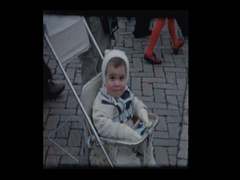 Baby boy in stroller looking at animals at the zoo Stock Footage