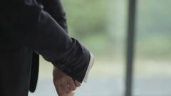 Businessman adjusting sleeves Stock Footage