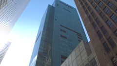 CLOSE UP: Giant glassy skyscrapers and tall office building in metropolitan city Stock Footage