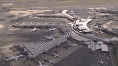 AERIAL: Infrastructure of an airport terminal building on New York airport Stock Footage