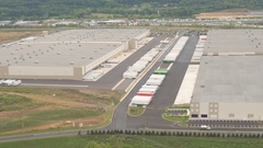 AERIAL: Large modern logistic and transportation center with big warehouses Stock Footage