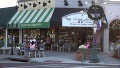 Tourists visit shop, St Armands Circle, Sarasota, Florida, USA Stock Footage