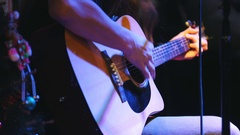 Guitarist is holding acoustic guitar near microphone at concert in club Stock Footage