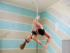Beautiful woman doing pole dance, female dancer Stock Footage