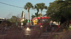 Traffic drives round St Armands Circle, Sarasota, Florida, USA Stock Footage