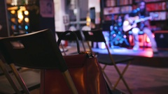 Bag is on the chair - empty room in front of the guitarist at concert - acoustic Stock Footage