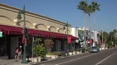 Visitors, shops and traffic, St Armands Circle, Sarasota, Florida, USA Stock Footage