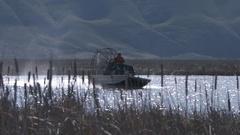Air boat through reeds at Idaho Wildlife Refuge medium Stock Footage