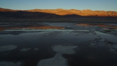 Owens Lake Aerial Sunset - Fly towards Death Valley Stock Footage