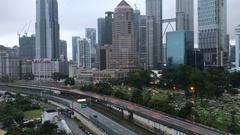 Kuala Lumpur city skyline during hazy, misty and cloudy morning. Tilt up Stock Footage