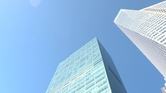 CLOSE UP: Iconic 1 WTC building reflecting in glassy skyscraper on sunny day Stock Footage