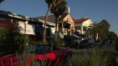 Red sports car, St Armands Circle, Sarasota, Florida, USA Stock Footage