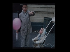 Big brother and Little boy in stroller with pink balloon Stock Footage