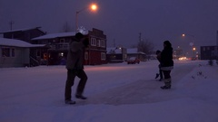 Small Town Winter Street Scene Shoveling Snow in Evening HD Stock Footage