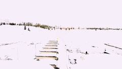 Aerial view of frozen marina in the mountains. Stock Footage
