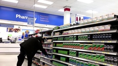 People taking medicine at pharmacy section inside Walmart store Stock Footage