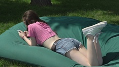 Happy young girl use smartphone in public place modern life concept. Slow mo Stock Footage