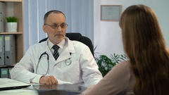 Doctor informing female patient about good results of brain MRI, recovery Stock Footage